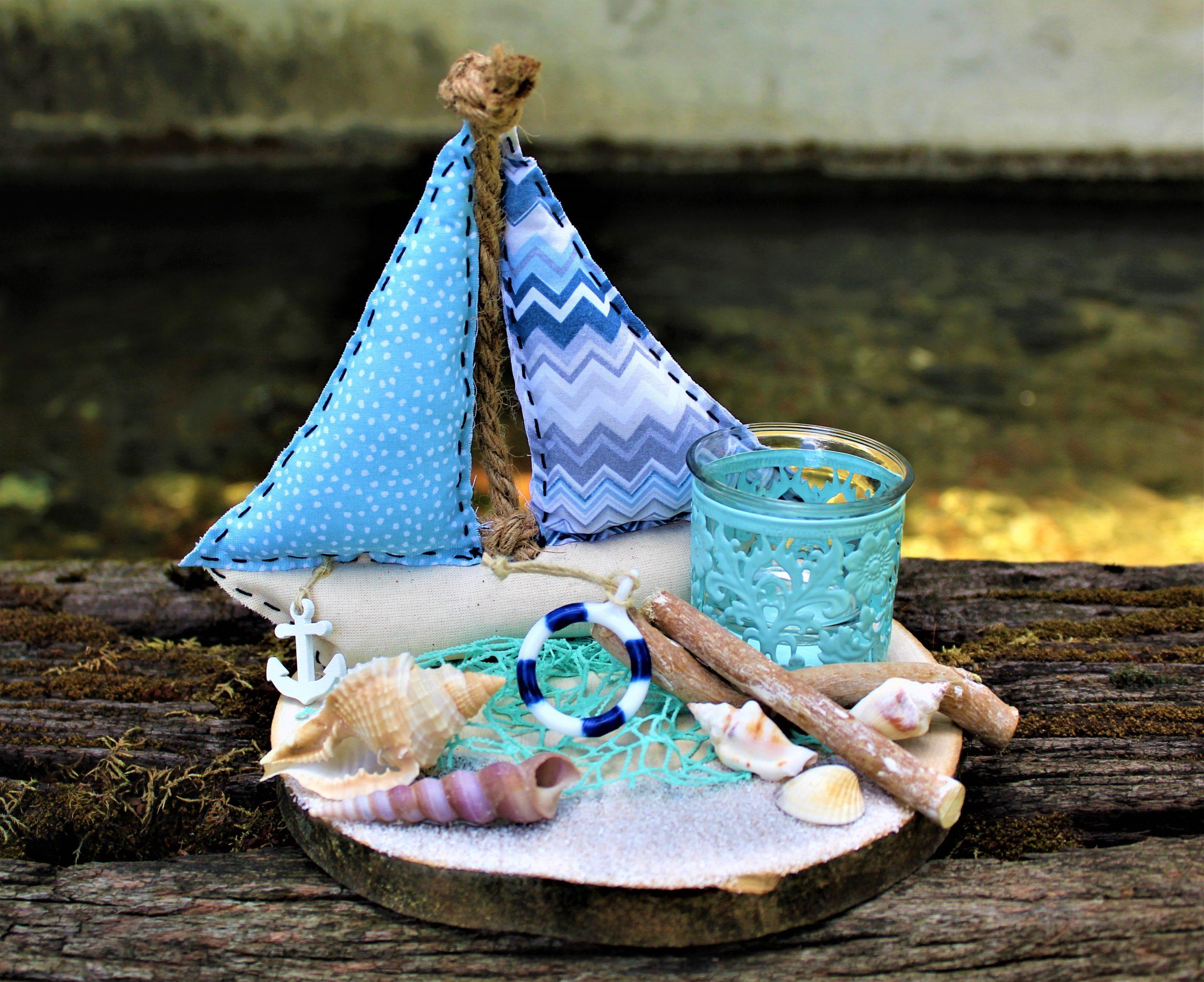 centrotavola-estate-barca-stoffa-conchiglie-porta-candela