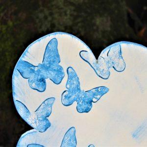 portaciotole-gatto-farfalle-azzurre-dettaglio